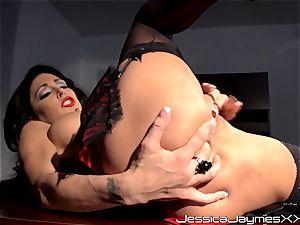 horny brunette Jessica Jaymes thumbs her jiggly vulva pie in her office