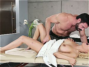 Married platinum-blonde bombshell getting insatiable by a muscled masseuse