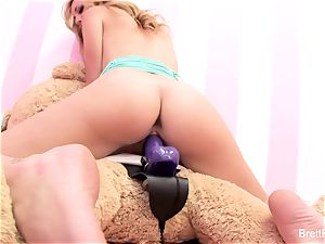 Brett Rossi plays with a wedged bear's strap-on fake penis