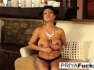Indian cougar Priya taunts then satiates her wonderful wet slot