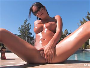 Everyone's dearest adult movie star Asa teases by the pool
