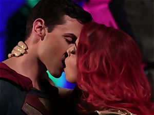 Britney Amber gargles off a ultra-kinky superhero