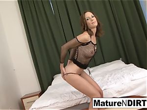 dark-haired cougar wanks before taking a big black cock