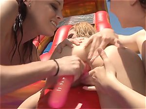 slippery slide wet lesbian stunners gobbling out poon outdoors